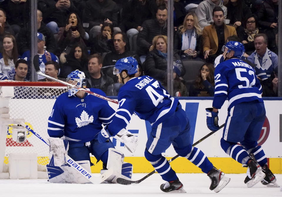 Toronto Maple Leafs left wing Pierre Engvall (47) moves to chase the puck as teammates Frederik Andersen (31) and Martin Marincin (52) look on during second-period NHL hockey game action against the Vancouver Canucks in Toronto, Saturday, Feb. 29, 2020. (Frank Gunn/The Canadian Press via AP)