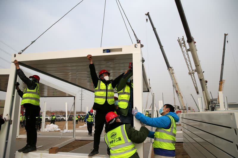 Construction workers set up a centralised quarantine site at Guying village in Shijiazhuang
