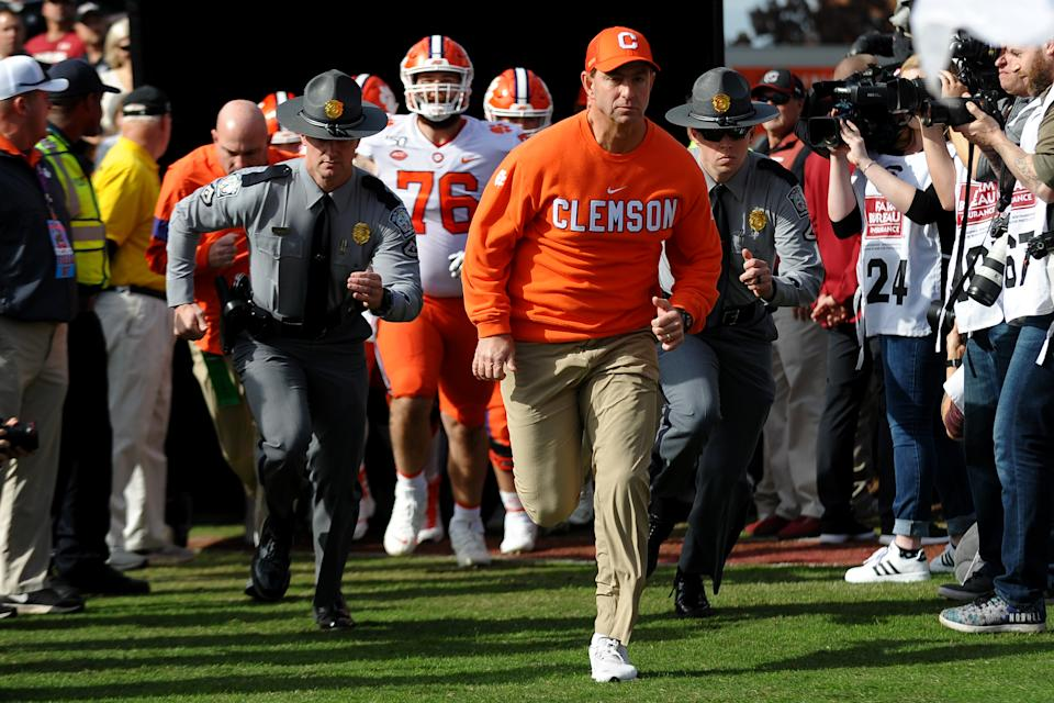 Clemson Tigers head coach Dabo Swinney leads his team onto the field prior to the game between the Clemson Tigers and the South Carolina Gamecocks on Nov. 30. (Dannie Walls/Getty Images)