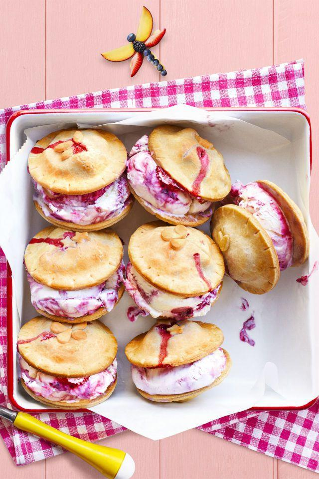 """<p>These mixed berry ice cream sandwiches  -  complete with pie crust ends  -  get an extra touch of sweetness thanks to strawberry jam.</p><p><strong><a rel=""""nofollow"""" href=""""https://www.womansday.com/food-recipes/food-drinks/recipes/a59001/fresh-berry-ice-cream-piewiches-recipe/"""">Get the recipe.</a></strong></p>"""