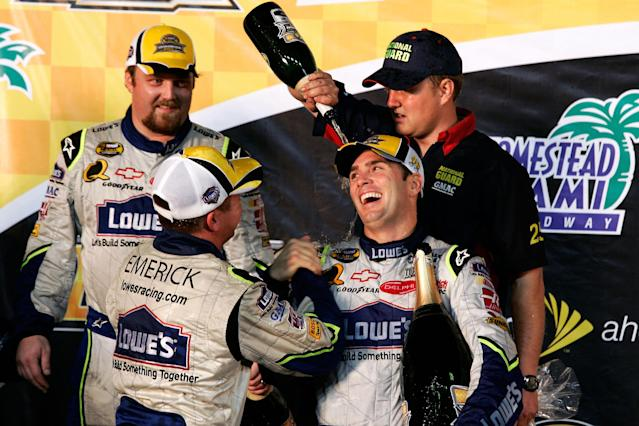 Jimmie Johnson, driver of the #48 Lowe's Chevrolet, celebrates with teammates after clinching the NASCAR Nextel Cup Series Championship following the Ford 400 at Homestead-Miami Speedway on November 18, 2007 in Homestead, Florida. (Photo by Jason Smith/Getty Images for NASCAR)