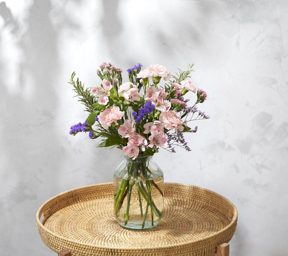 """<p>This one's a real feast for the senses. With aromatic rosemary and fluffy carnations, Jules smells just as great as she looks.</p><p><a class=""""link rapid-noclick-resp"""" href=""""https://go.redirectingat.com?id=127X1599956&url=https%3A%2F%2Fwww.bloomandwild.com%2Fsend-flowers%2Fsend%2Fthe-jules%2F3300&sref=https%3A%2F%2Fwww.prima.co.uk%2Fhome-ideas%2Fg35359342%2Fbloom-wild-valentines-day-red-roses%2F"""" rel=""""nofollow noopener"""" target=""""_blank"""" data-ylk=""""slk:BUY NOW"""">BUY NOW</a></p>"""