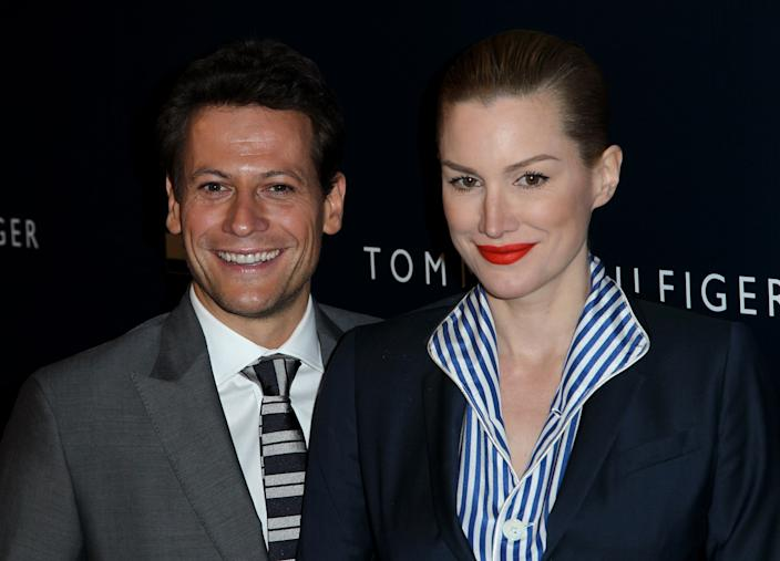 Ioan Gruffudd, left, and Alice Evans arrive at Tommy Hilfiger's new west coast flagship store opening in Los Angeles, Wednesday, Feb. 13, 2013. (Photo by Matt Sayles/Invision/AP)