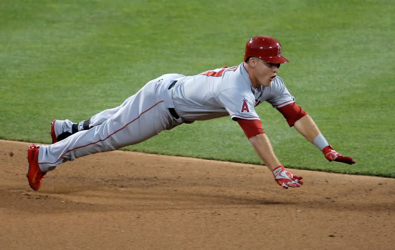 The American League's Mike Trout, of the Los Angeles Angels, dives into second base for a lead-off double in the first inning against the National League during Major League Baseball's All-Star Game in New York