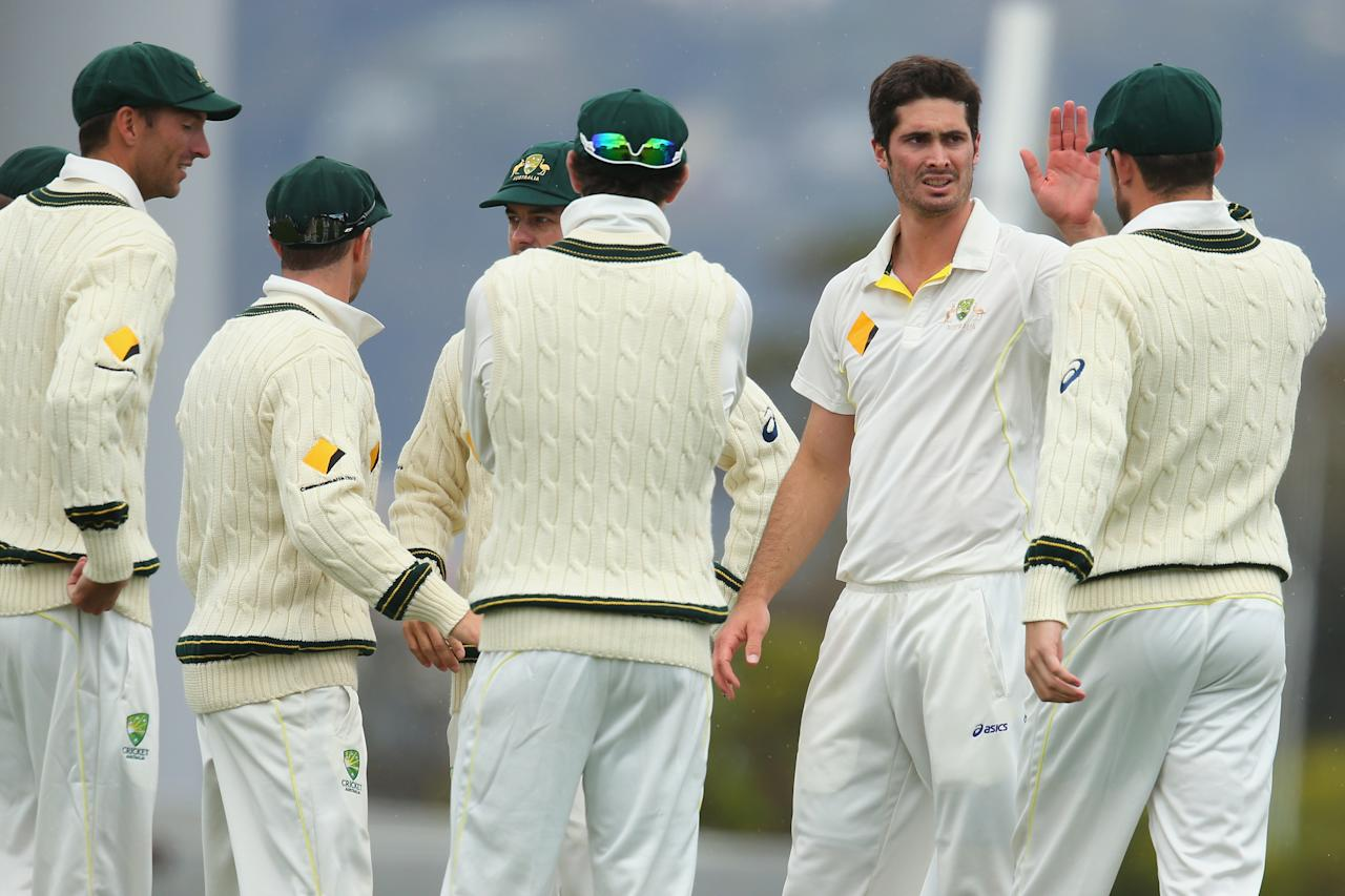 HOBART, AUSTRALIA - NOVEMBER 09:  Ben Cutting of Australia A celebrates with his tam mates after taking the wicket of Jonathan Trott of England during day four of the tour match between Australia A and England at Blundstone Arena on November 9, 2013 in Hobart, Australia.  (Photo by Mark Kolbe/Getty Images)