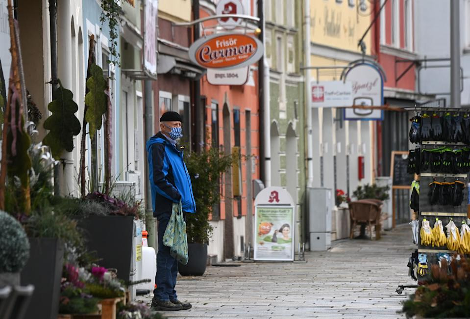 A man wears a face mask while standing on a street in Pfarrkirchen, a town of the county district Rottal-Inn in Bavaria, on October 27, 2020 after a local lockdown was imposed because of the coronavirus Covid-19 pandemic. (Photo by Christof STACHE / AFP) (Photo by CHRISTOF STACHE/AFP via Getty Images)