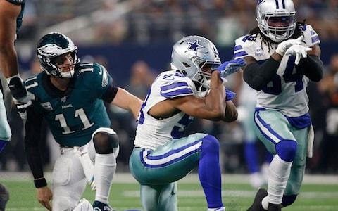 Dallas Cowboys defensive end Robert Quinn (58) and middle linebacker Jaylon Smith (54) react to a sack of Philadelphia Eagles quarterback Carson Wentz (11) in the second quarter at AT&T Stadium - Credit: USA Today