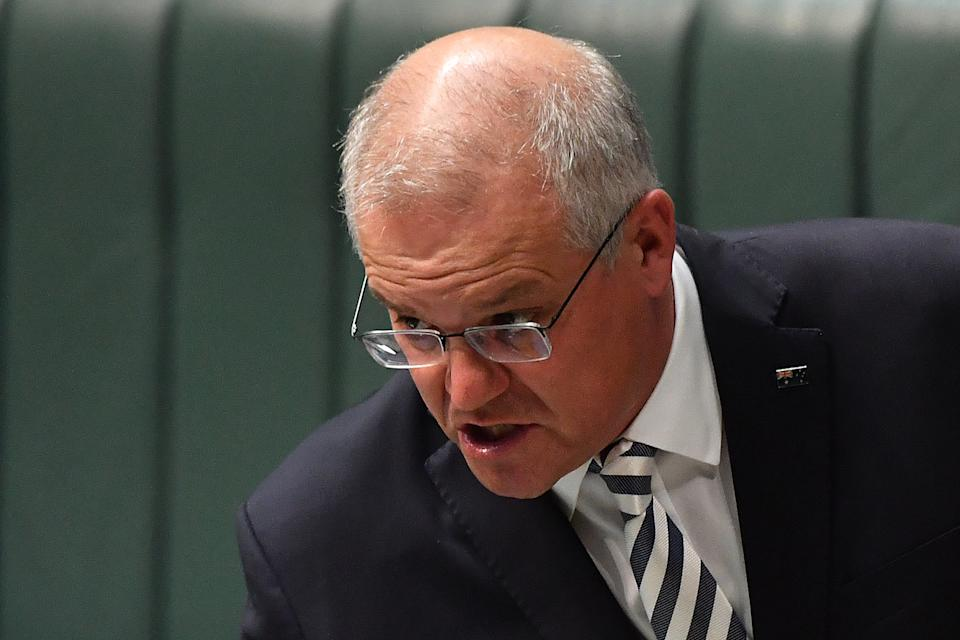 CANBERRA, AUSTRALIA - MARCH 25: Prime Minister Scott Morrison during Question Time in the House of Representatives at Parliament House on March 25, 2021 in Canberra, Australia. The federal government was on Monday set back by new allegationsbroadcastby the Ten Network after pixelated images of unnamed Coalition advisers allegedly engaging in performing lewd sex acts on the desks of female MPs resulting in a Morrison staff member being sacked last night. Additionally, the ABC Network aired a first hand account by an Australian Parliament security guard of what she witnessed on the night Brittany Higgins was allegedly raped in the office of then-defence industry minister Linda Reynolds in early 2019. (Photo by Sam Mooy/Getty Images)