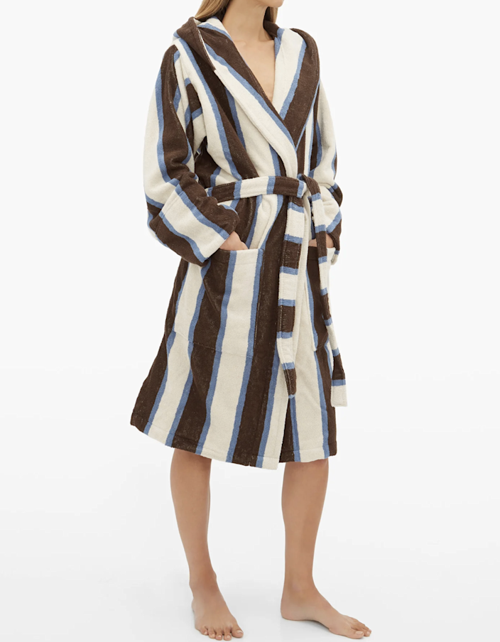 "Add an elevated feel to your post-shower routine with this striped bathrobe from Scandi brand, Tekla. Harry Styles and Alexa Chung <a href=""https://graziadaily.co.uk/fashion/news/harry-styles-tekla-robe/"" rel=""nofollow noopener"" target=""_blank"" data-ylk=""slk:both own one"" class=""link rapid-noclick-resp"">both own one</a>, so you know you're in good company. $167, Matches Fashion. <a href=""https://www.matchesfashion.com/us/products/Tekla-Hooded-cotton-terry-bathrobe-1317899"" rel=""nofollow noopener"" target=""_blank"" data-ylk=""slk:Get it now!"" class=""link rapid-noclick-resp"">Get it now!</a>"