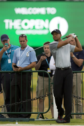 Tiger Woods of the US plays a shot off the 3rd tee during a practice round at the Royal Liverpool Golf Club prior to the start of the British Open Golf Championship, in Hoylake, England, Saturday, July 12, 2014. The 2014 Open Championship starts on Thursday, July 17. (AP Photo/Jon Super)