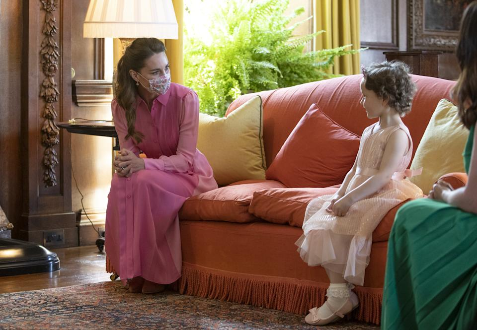 The Duchess of Cambridge and cancer patient, Mila Sneddon,coordinate in pink dresses