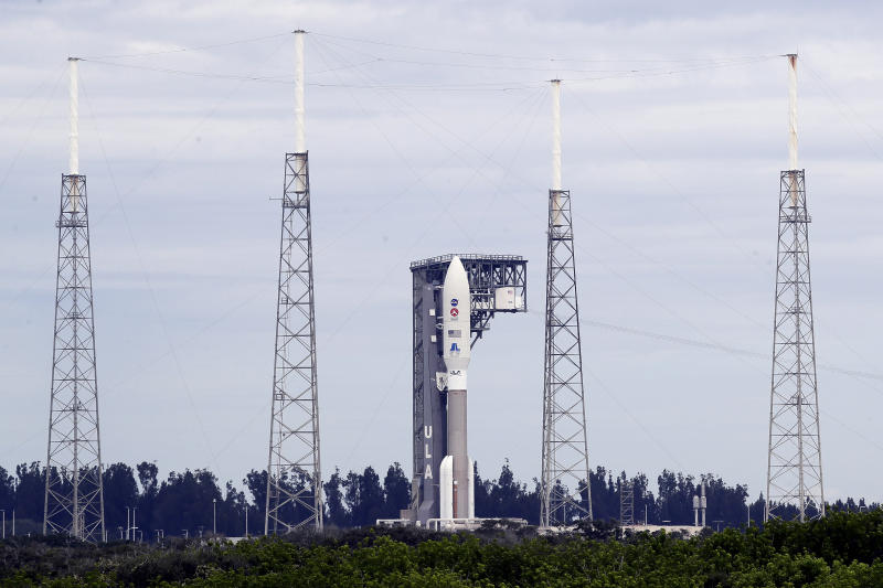 A United Launch Alliance Atlas V rocket that will launch to Mars arrives at Space Launch Complex 41 at the Cape Canaveral Air Force Station, Tuesday, July 28, 2020, in Cape Canaveral, Fla. The rocket scheduled to launch on Thursday will land on Mars in February 2021 and the Mars 2020 rover, named Perseverance, will study Martian geology. (AP Photo/John Raoux)