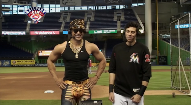 Giancarlo Stanton stands beside Christian Yelich while wearing Marcell Ozuna's King Tut outfit. (MLB.com)
