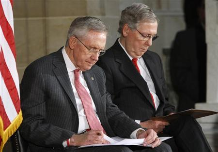 Reid and McConnell look at their notes during a ceremony for the 50th anniversary of the March on Washington for Jobs and Freedom at the U.S. Capitol in Washington