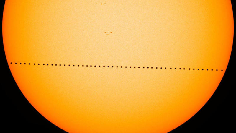 A time-lapse image provided by NASA, shows the tiny dot of Mercury sliding across the sun the during the transit of Mercury on May 9, 2016. (NASA via The New York Times)