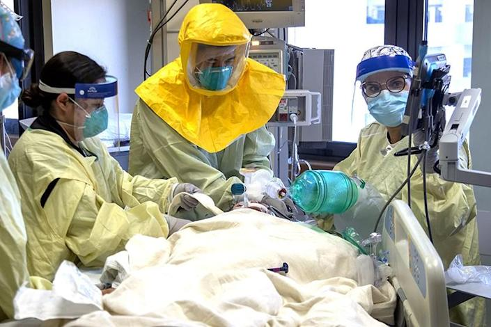 A COVID-19 patient is treated in the ICU at Loma Linda University Medical Center.