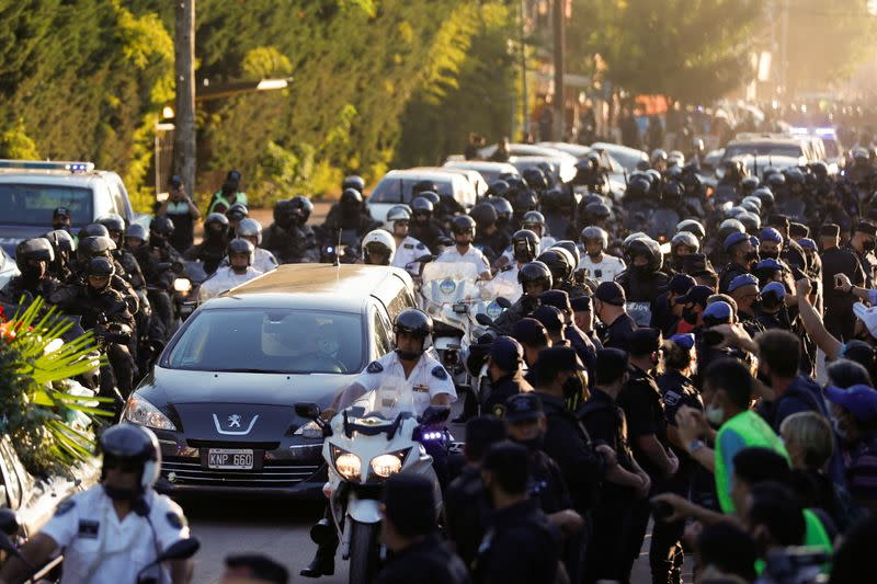 The hearse carrying the casket of soccer legend Diego Maradona arrives at the cemetery in Buenos Aires, Argentina