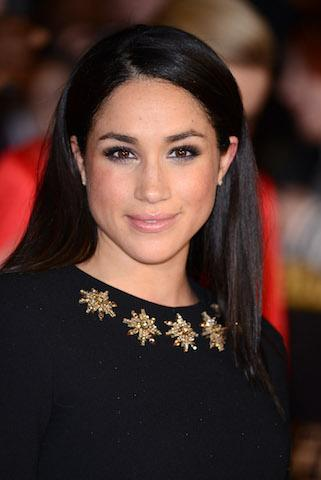<p>For the UK premiere of 'The Hunger Games: Catching Fire' in 2013, Meghan rocked slick hair tucked behind her ears. <em>[Photo: Getty]</em> </p>