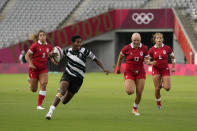 Fiji's Ana Maria Naimasi runs with the ball, pursued by Canada's Bianca Farella, left, Olivia Apps, second right, and Breanne Nicholas in their women's rugby sevens match at the 2020 Summer Olympics, Thursday, July 29, 2021 in Tokyo, Japan. (AP Photo/Shuji Kajiyama)