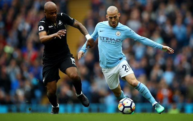 "4:57PM Incredible stuff David Silva the 6th City player into double figures for the season now. That was his 10th of the campaign in all comps. Others: Aguero 30, Sterling 23, including one here v Swansea, Jesus 14, Sane 13, De Bruyne 11 #MCFC— James Ducker (@TelegraphDucker) April 22, 2018 4:54PM 25 mins It hits the wall, and City scramble it clear. 4:54PM 24 mins Sterling is adjudged to have pulled back King after City clear, and Swansea have a free-kick in a decent position. Olsson is over it, 25 yards from goal, right of centre. 4:53PM 22 mins Delph tries the most audacious of first time volleys, hitting Sterling's ball out to him back across goal, but it flies wide of the post. 4:51PM 20 mins Swansea haven't even got close to touching the ball within 30 yards of the City goal, and it has just been one way traffic so far. Carvalhal said Swansea had a plan to stop City, but there is no way back from this now. It's just a question of how many City get. Man City vs Swansea 4:47PM GOOOOOAAAAAL! Sterling makes it 2-0! Delph stands Naughton up, plays a swift one-two with Silva, and drills low across goal where a grateful Raheem Sterling is waiting to tap home his 18th league goal of the season. Man City 2 - 0 Swansea (Raheem Sterling, 16 min) 4:46PM 14 mins Celebrations galore at the Etihad: Credit: afp Credit: AFP 4:45PM GOOOOOOOAAAAALL!!! David Silva puts City 1-0 up Just like that (see last post) Silva is in fact on the end of a move, after De Bruyne picks Sterling out with a lovely ball with the outside of his boot around the defender on the City left. Sterling runs onto it, and cuts back to Silva, who takes one touch before thrashing home from an angle. 1-0 City and it's just so easy for them. Man City 1 - 0 Swansea (David Silva, 12 min) 4:41PM 10 mins Silva is running things in midfield, seeing plenty of the ball between the lines, and it surely won't be long until he picks out a killer final ball. Swansea already making a few desperate challenges to stay level. 4:38PM 6 mins Olsson just took the worst cross I have ever seen. It went at about 90 degrees away from the direction he'd intended. Real Sunday League stuff. Truly beautiful. 4:33PM 3 mins ""Stand up for the champions"" is being sung in the Etihad stands. Haven't yet heard anyone sing 'if you're happy and you know it'. Yet City settling into plenty of early possession. Swansea are working very hard indeed. This could be a long afternoon. 4:30PM Off we go Thanks for the Guard of Honour and the warm reception @SwansOfficial and fans. Here's to a great game! �� #cityvswans#mancity— Manchester City (@ManCity) April 22, 2018 Let's get on with the footy! City get things started. 4:27PM The celebrations We've just had a guard of honour for the champions, and after the game we'll see Vincent Kompany lift the Premier League trophy... again. Swansea's players clap City's onto the pitch 4:19PM Swansea's warm-up Sky have just shown a clip of Swansea's back five warming up by moving in a line back and forth, side to side, in perfect co-ordination. They'll have to play like that to for 90 minutes to get anything from today's game. 4:16PM Carlos Carvalhal talks ""I understand the past: City have only lost one game at home, usually scoring three, four, five goals. They are champions, they are the best team and one of the best in Europe. ""We know about all of this. From our side, we have a strategy to try and stop them, it won't be easy because they are so strong, but we also have a strategy to try and play and our football and score goals. ""We will do our best to try and achieve something. Let's play!"" 4:07PM They've let the fans get hold of the trophy outside the ground Credit: Reuters Credit: getty images (I think it's probably a replica trophy.) 3:59PM At the other end of the table After Stoke's draw with Burnley, Swansea remain four points clear of safety with one game in hand over Southampton and two over Stoke. They have every chance of survival, but they will still want to try and get something from today's game. Away to the champions, though, they will be up against it. 3:38PM It's good to have him back it's been a long run, but the Shark is finally back on track �� @ManCitypic.twitter.com/Kd7Xc1LF68— Benjamin Mendy (@benmendy23) April 22, 2018 3:35PM Swansea team �� Today's team news from the Etihad Stadium...#MCISWApic.twitter.com/trz3dI8KfV— Swansea City AFC (@SwansOfficial) 22 April 2018 3:35PM Benjamin Mendy returns to the squad Your Champions line-up like this! �� City XI: Ederson, Danilo, Kompany (C), Laporte, Delph, Gündogan, De Bruyne, Bernardo, Silva, Sterling, Jesus Subs: Bravo, Walker, Sané, Mendy, Otamendi, Touré, Foden Presented by @HAYSWorldwidepic.twitter.com/W6TduoN1X5— Manchester City (@ManCity) 22 April 2018 3:34PM Stand up for the champions The banners are ready and the champagne on ice for Manchester City, who are having at party at the Etihad Stadium against Swansea City. City's season did seem to be winding down to an anti-climactic finish after defeats in the Manchester Derby and the Champions League quarter-final against Liverpool. A comprehensive performance and victory over Spurs was a worth exclamation point at the end of their league campaign however, and they were confirmed as champions when West Brom won at Man Utd. Team news to follow..."