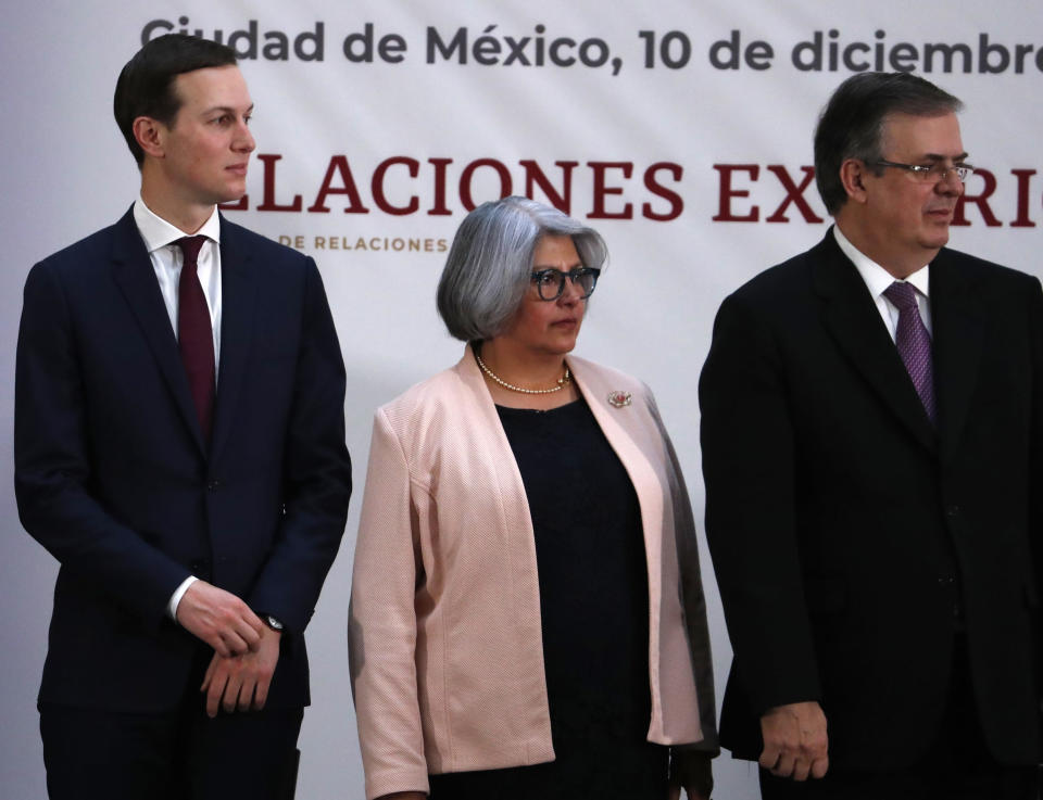 White House senior adviser Jared Kushner, left, Mexico's Economy Minister Graciela Marquez, center, and Mexico's Foreign Minister Marcelo Ebrard stand during a ceremony to sign an update to the North American Free Trade Agreement, at the national palace in Mexico City, Tuesday, Dec. 10. 2019. (AP Photo/Marco Ugarte)
