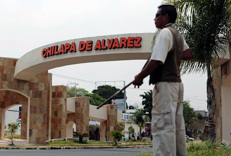 Armed civilians stand guard at the entrance to Chilapa in Guerrero State, southern Mexico on May 10, 2015 (AFP Photo/Pedro Pardo)