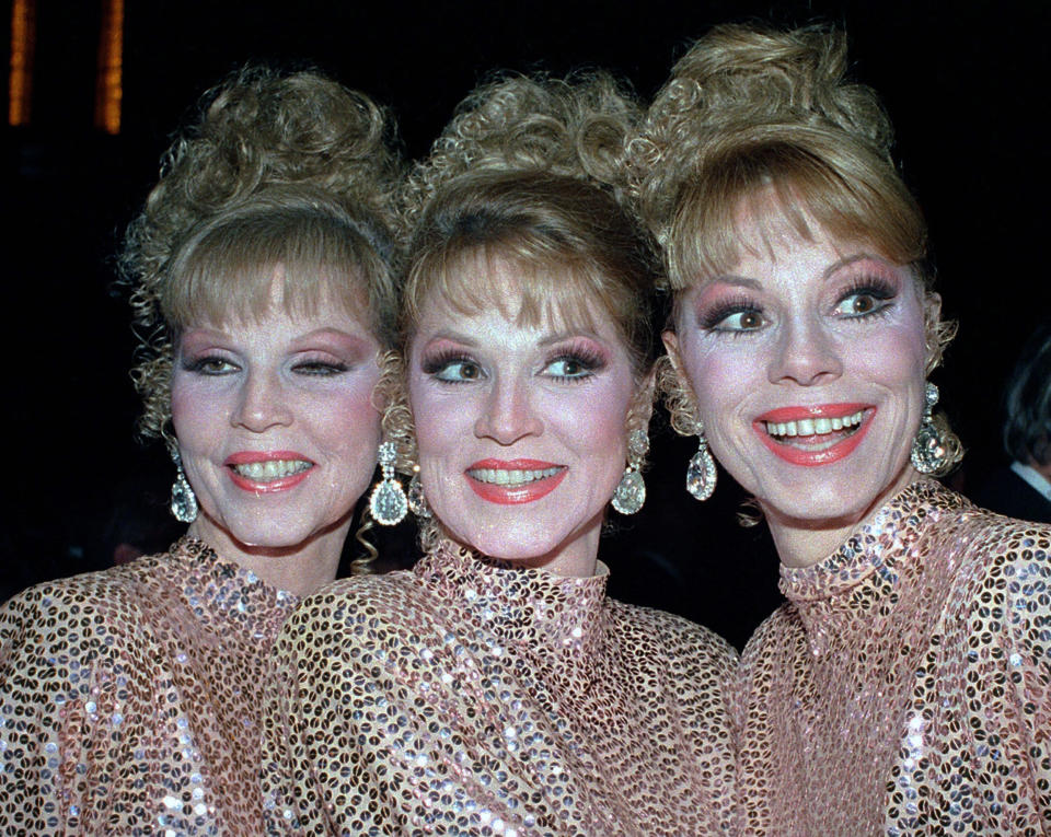 FILE - In this Thursday, Oct. 10, 1986 file photo, The McGuire Sisters, from left, Christine, Phyllis and Dorothy, pose outside Radio City Music Hall in New York. Phyllis McGuire, the last surviving member of the three singing McGuire Sisters who topped the charts with several hits in the 1950s, has died, Tuesday, Dec. 31, 2020. She was 89. (AP Photo/Ed Bailey, File)