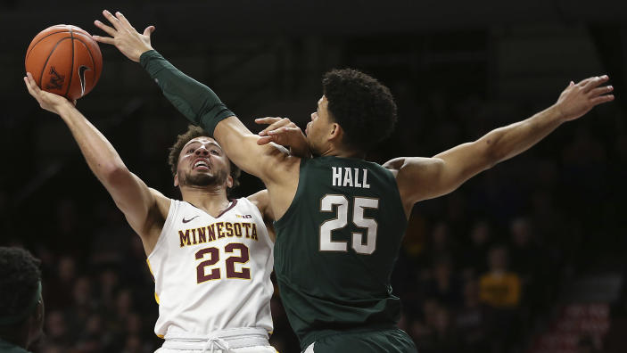 Minnesota's Gabe Kalscheur (22) shoots over Michigan State's Malik Hall during an NCAA college basketball game Sunday, Jan. 26, 2020, in Minneapolis. (AP Photo/Stacy Bengs)