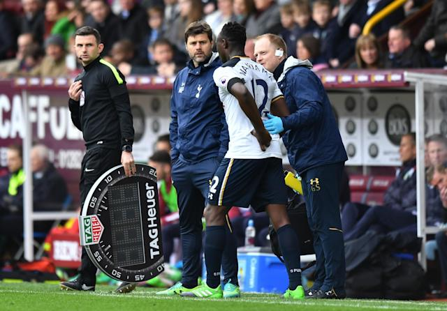 Tottenham's Victor Wanyama receives medical treatment before being substituted off as Tottenham manager Mauricio Pochettino looks on