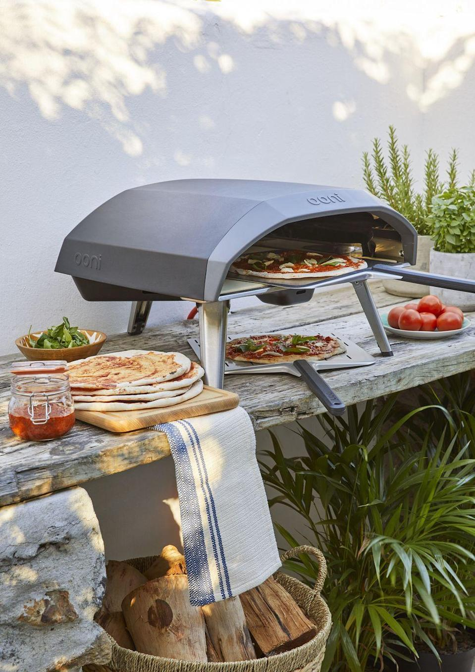 """<p>Get set for a summer <a href=""""https://www.countryliving.com/uk/homes-interiors/gardens/a33452894/sustainable-bbq-ideas/"""" rel=""""nofollow noopener"""" target=""""_blank"""" data-ylk=""""slk:barbecue"""" class=""""link rapid-noclick-resp"""">barbecue</a> with John Lewis' must-have range of dining essentials. From pizza ovens to serving platters, you'll find everything you need for a summertime feast.</p><p><a class=""""link rapid-noclick-resp"""" href=""""https://go.redirectingat.com?id=127X1599956&url=https%3A%2F%2Fwww.johnlewis.com%2Fbrowse%2Fhome-garden%2Fbbqs-outdoor-heating%2Fbbqs%2F_%2FN-5upb&sref=https%3A%2F%2Fwww.countryliving.com%2Fuk%2Fhomes-interiors%2Fgardens%2Fg35933581%2Fjohn-lewis-garden-collection-spring-summer%2F"""" rel=""""nofollow noopener"""" target=""""_blank"""" data-ylk=""""slk:SHOP NOW"""">SHOP NOW</a></p>"""