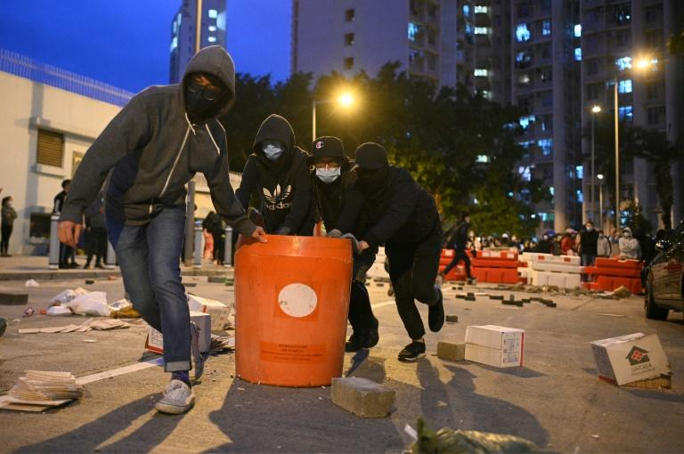 Residents set up barricades near the vacant Fai Ming Estate to protest against plans for the estate to be used as a quarantine camp for patients and frontline medical staff of the Novel Coronavirus (AFP Photo/Philip FONG)