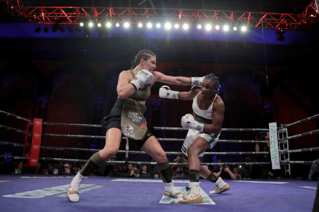 Christina Hammer, left, and Claressa Shields fight during the third round of a women's world middleweight championship boxing bout Saturday, April 13, 2019, in Atlantic City, N.J. (AP Photo/Julio Cortez)