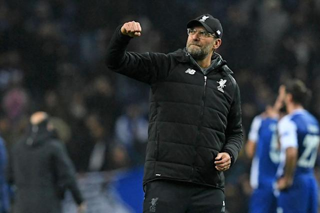 High five: Liverpool manager Jurgen Klopp celebrates after Liverpool demolish Porto 5-0 in the Champions League (AFP Photo/Francisco LEONG)