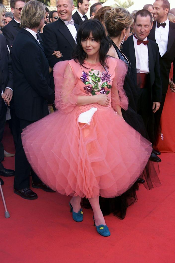 Bjork at the 200 Cannes Film Festival in a pink dress and blue heels.