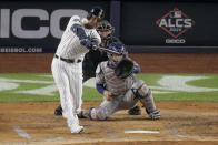 FILE - In this Oct. 18, 2019, file photo, New York Yankees' Aaron Hicks connects for a three-run home run against the Houston Astros during the first inning of Game 5 of baseball's American League Championship Series, in New York. Yankees general manager Brian Cashman is optimistic Aaron Judge, James Paxton, Aaron Hicks and Giancarlo Stanton will be ready to play in time for New York's rescheduled opener at World Series champion Washington on July 23.(AP Photo/Seth Wenig, File)