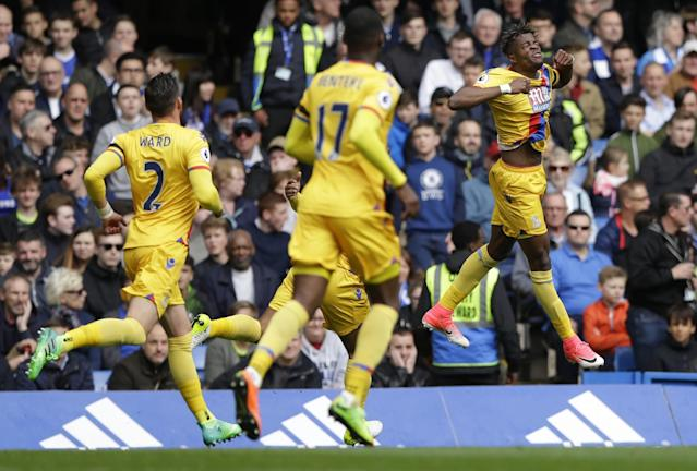 <p>Crystal Palace's Wilfried Zaha celebrates scoring their first goal </p>