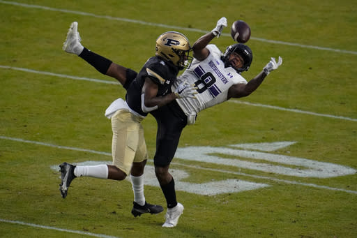 Purdue cornerback Dedrick Mackey (1) breaks up a pass to Northwestern wide receiver Kyric McGowan (8) during the first half of an NCAA college football game in West Lafayette, Ind., Saturday, Nov. 14, 2020. (AP Photo/Michael Conroy)