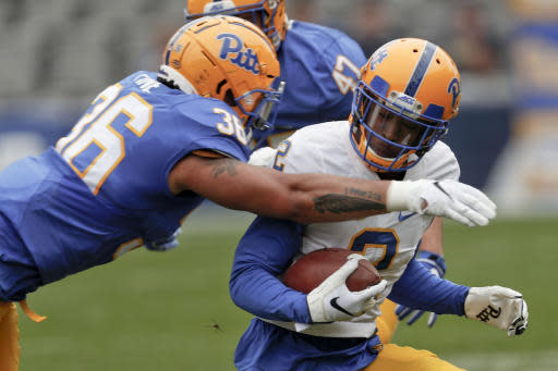 Pittsburgh wide receiver Maurice Ffrench (2) is hit by linebacker Chase Pine (36) during their annual intrasquad Blue-Gold spring NCAA college football game, Saturday, April 13, 2019, in Pittsburgh. (AP Photo/Keith Srakocic)