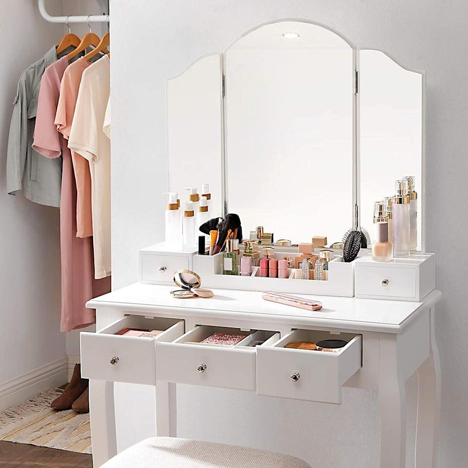 <p>This <span>Vasagle Makeup Vanity Set</span> ($130, originally $140) features a three-piece mirror so you can see your face from different angles.</p>