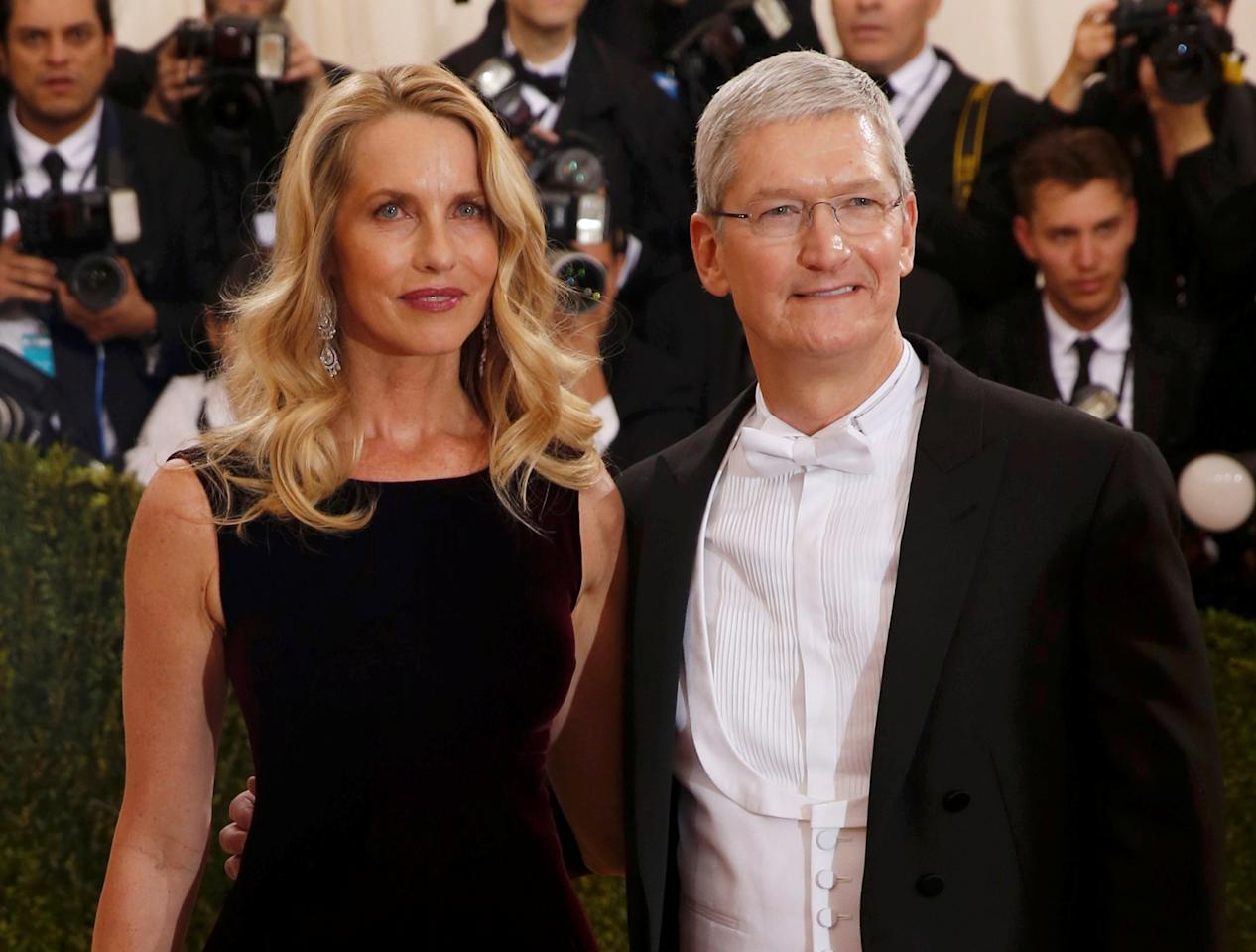 "Apple CEO Tim Cook and Steve Jobs' widow Laurene Powell arrive at the Metropolitan Museum of Art Costume Institute Gala (Met Gala) to celebrate the opening of ""Manus x Machina: Fashion in an Age of Technology"" in the Manhattan borough of New York, May 2, 2016. REUTERS/Lucas Jackson TPX IMAGES OF THE DAY"