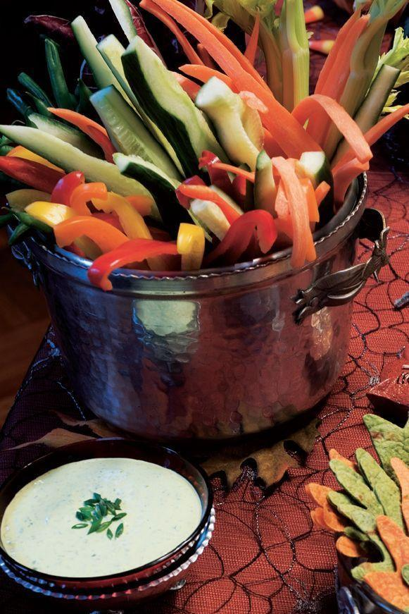 """<p>Make veggies much more fun during your Halloween party by cutting them up and accompanying them with an herb dip.</p><p><em><strong><a href=""""https://www.womansday.com/food-recipes/food-drinks/a28859236/crude-ites-with-green-slime-dip-recipe/"""" rel=""""nofollow noopener"""" target=""""_blank"""" data-ylk=""""slk:Get the Crude-Ités with Green Slime Dip recipe."""" class=""""link rapid-noclick-resp"""">Get the Crude-Ités with Green Slime Dip recipe.</a></strong></em></p>"""