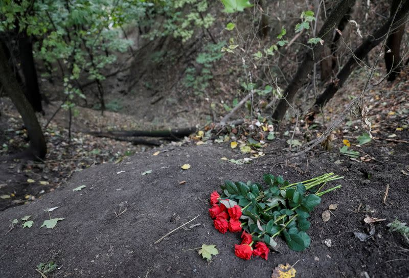 FILE PHOTO: Flowers are seen during a ceremony near a monument commemorating the victims of Babyn Yar in Kiev