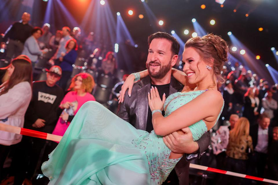 """06 March 2020, North Rhine-Westphalia, Cologne: Michael Wendler, singer, takes his girlfriend Laura Müller, TV personality, into his arms in the Coloneum after the RTL dance show """"Let's Dance"""". Photo: Rolf Vennenbernd/dpa (Photo by Rolf Vennenbernd/picture alliance via Getty Images)"""