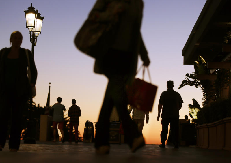 In this Thursday, Dec. 20, 2012 photo, people walk through the Fashion Island shopping center in Newport Beach, Calif. U.S. holiday retail sales this year are the weakest since 2008, after a shopping season disrupted by storms and rising uncertainty among consumers.  A report out Tuesday, Dec. 25, 2012, that tracks spending, called MasterCard Advisors SpendingPulse, says holiday sales increased 0.7 percent. Analysts had expected sales to grow 3 to 4 percent.  (AP Photo/Chris Carlson, File)