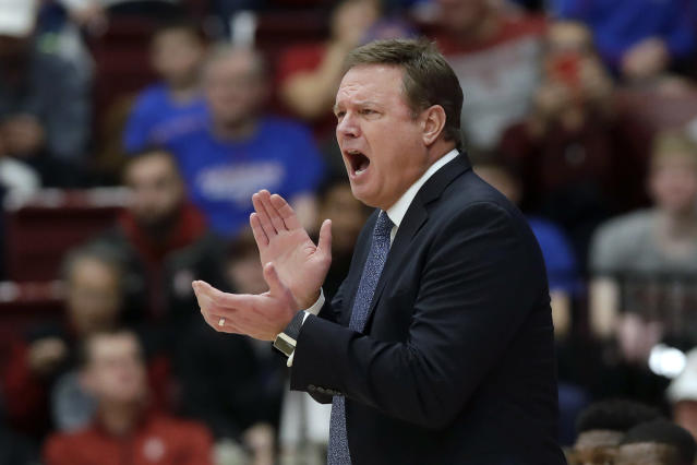 FILE - In this Dec. 29, 2019, file photo, Kansas head coach Bill Self yells during the first half of an NCAA college basketball game against Stanford in Stanford, Calif. Kansas finished the season No. 1 in The Associated Press college basketball poll, receiving 63 of 65 first-place votes from a national media panel Wednesday, March 18, 2020. (AP Photo/Jeff Chiu, File)