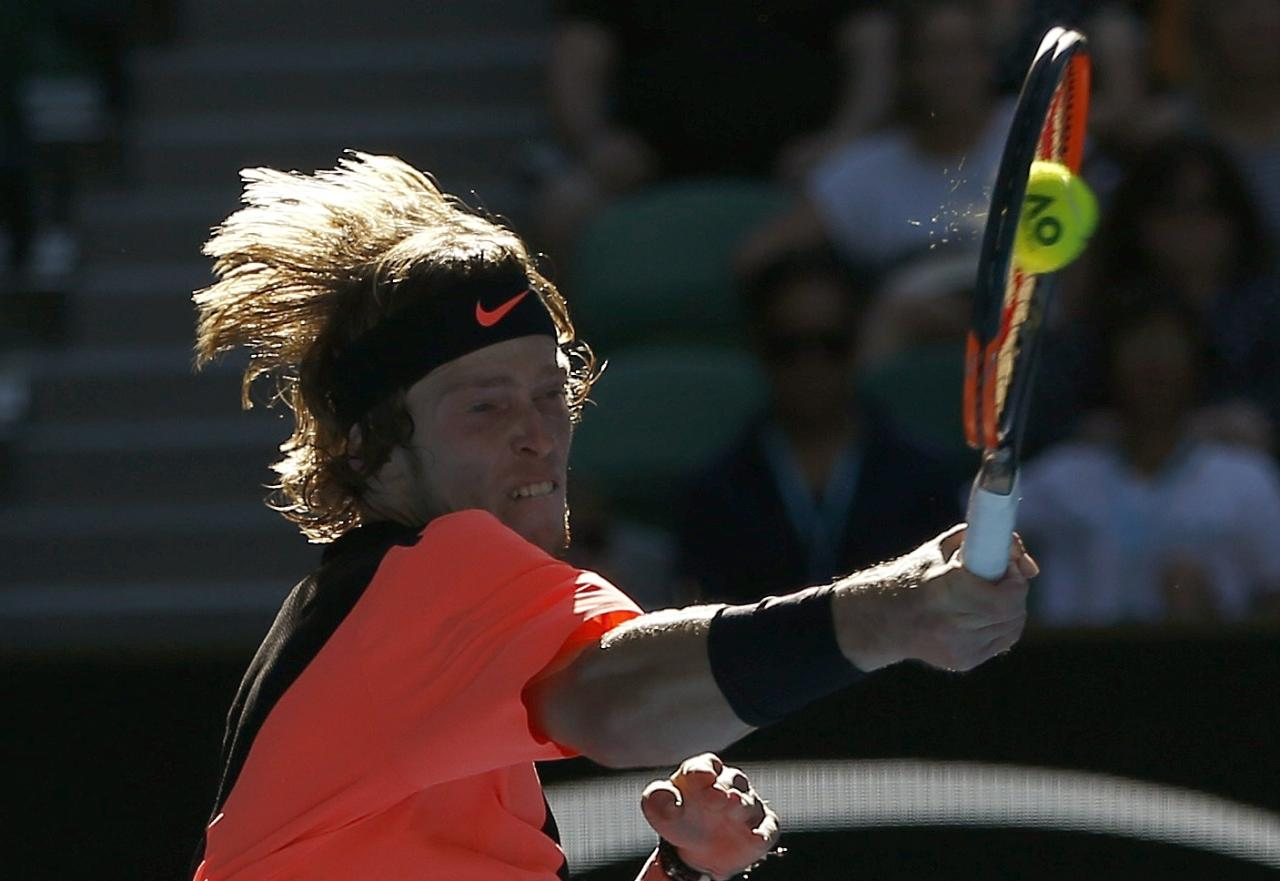 Tennis - Australian Open - Rod Laver Arena, Melbourne, Australia, January 19, 2018. Andrey Rublev of Russia hits a shot against Grigor Dimitrov of Bulgaria. REUTERS/Thomas Peter   TPX IMAGES OF THE DAY