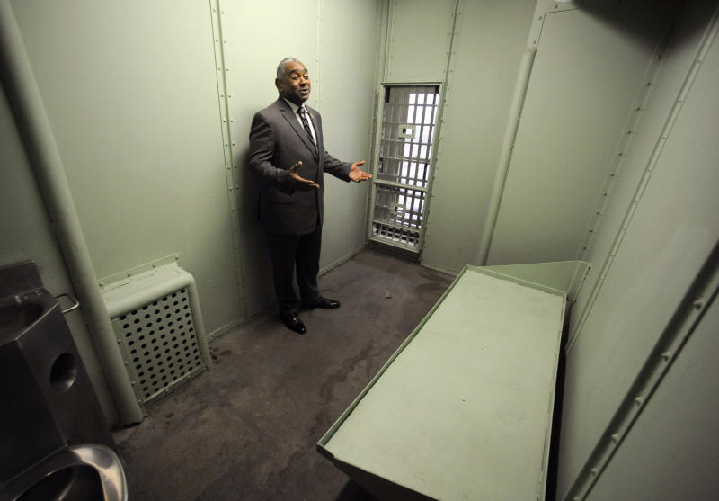 In this Friday, Jan. 10, 2020 photo, Jefferson County Sheriff Mark Pettway speaks in a cell at the old county jail in Birmingham, Ala. The county is taking steps to preserve the long-forgotten lockup, where officials say Dr. Martin Luther King Jr. served his final stint behind bars in 1967 about five months before his assassination. (AP Photo/Jay Reeves)