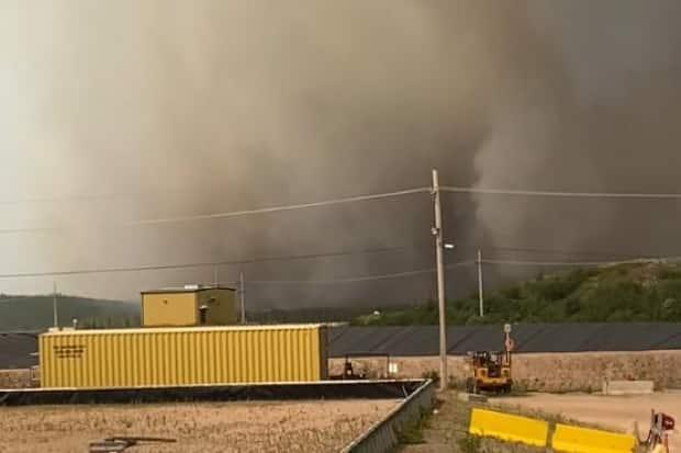 This photo shows smoke from a forest fire near Cigar Lake uranium mine in northern Saskatchewan in the beginning of July.  (Submitted by Moriah Dyck - image credit)