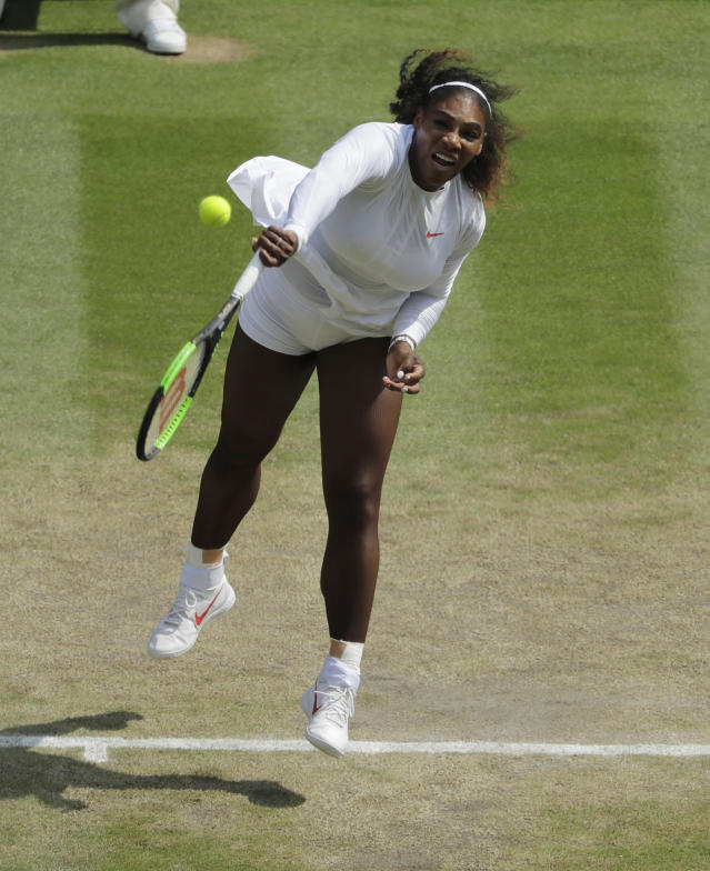 Serena Williams of the US serves to Julia Goerges of Germany during their women's semifinal match at the Wimbledon Tennis Championships in London, Thursday July 12, 2018. (AP Photo/Ben Curtis, Pool)