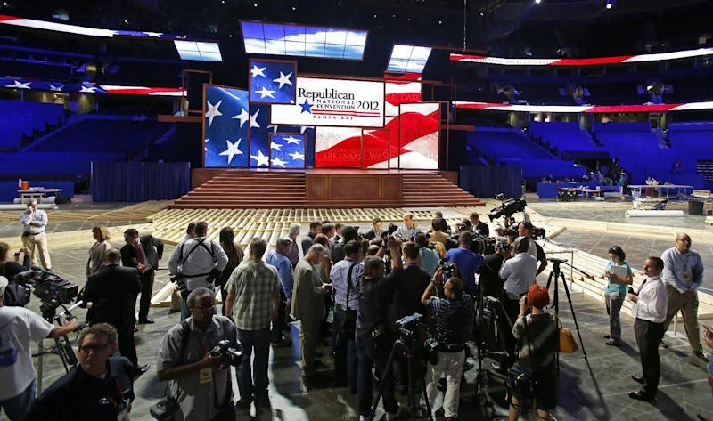 Members of the media conduct interviews on the floor after the unveiling of the stage and podium for the 2012 Republican National Convention, Monday, Aug. 20, 2012, at the Tampa Bay Times Forum in Tampa, Fla. (AP Photo/Scott Iskowitz)